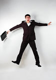 Businessman jumping. Adult businessman jumping on white Stock Photo