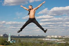 Businessman jumping. The man jumping in the air Stock Image