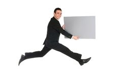 Businessman jumping. With blank placard Stock Images