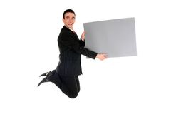 Businessman jumping. With blank placard Stock Image
