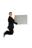 Businessman jumping. With blank placard Royalty Free Stock Images