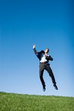 Businessman jumping stock image