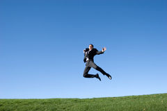 Businessman jumping royalty free stock image