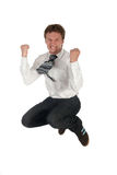 Businessman jumping. Young businessman jumping Royalty Free Stock Image