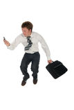 Businessman jumping. Young businessman jumping Royalty Free Stock Photography