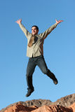 Businessman jumping in the air Royalty Free Stock Photos