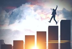 Businessman jumping in a big city, bar chart. Silhouette of a young businessman jumping on a bar chart against a big city sky background. Concept of business royalty free illustration