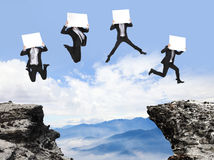 Businessman jumping with billboard on the mountain Royalty Free Stock Photo
