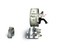 Businessman jumping through circle on stack of money symbols Royalty Free Stock Photography