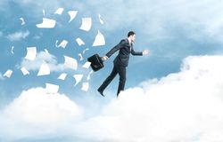 Businessman jumping from cloud Stock Images