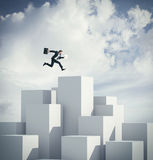 Businessman jumping on a cube. 3d rendering Royalty Free Stock Photos
