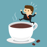 Businessman jumping on the cup of coffee Royalty Free Stock Image