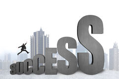 Businessman jumping on 3D success concrete word with city backgr Royalty Free Stock Photography