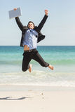 Businessman jumping in front of the sea Royalty Free Stock Photography