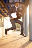 Businessman jumping, happy about the successful conclusion of a Stock Images