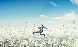 Businessman jumping high Royalty Free Stock Photo