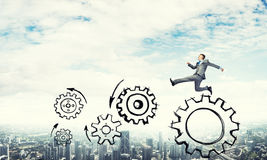 Businessman jumping high Royalty Free Stock Images
