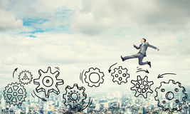 Businessman jumping high Royalty Free Stock Photography