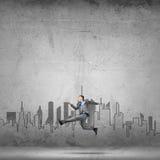 Businessman jumping high Stock Photo