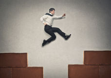 Businessman jumping high Royalty Free Stock Photos