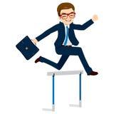 Businessman Jumping Hurdle Stock Photography
