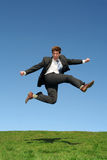 Businessman jumping for joy. Businessman Leaping for Joy Outdoors Royalty Free Stock Images