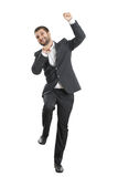 Businessman jumping and laughing Stock Photo
