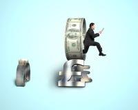 Businessman jumping through money circle Stock Photos