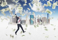 Businessman jumping, money rain Stock Photo