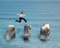 Businessman jumping on money symbol Stock Photography