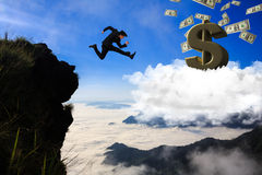 Businessman jumping from mountain. To cloud, Business concept royalty free stock photo