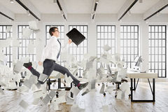 Businessman jumping in an office, papers. Side view of a young clerk with a suitcase jumping in an office. There are documents flying around him. 3d rendering Stock Photo