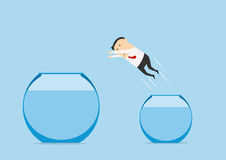 Businessman jumping out from one fish bowl to Royalty Free Stock Photography