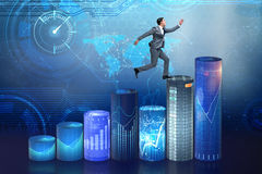 The businessman jumping over bar charts Royalty Free Stock Image