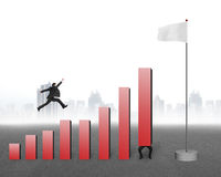 Businessman jumping over bar charts to blank flag with cityscape Stock Images
