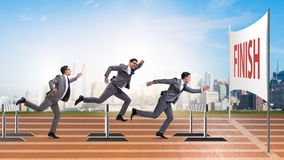 The businessman jumping over barriers in business concept Royalty Free Stock Photos