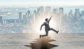 The businessman jumping over the cliff Royalty Free Stock Photo