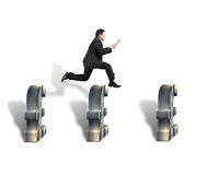 Businessman jumping over 3d pound symbols Stock Images