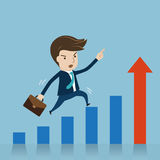 Businessman jumping over growing chart Royalty Free Stock Photography