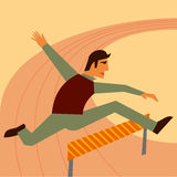 Businessman jumping over hurdle Royalty Free Stock Photography