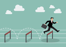 Businessman jumping over hurdle Royalty Free Stock Images