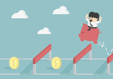 Businessman Jumping Over Hurdle To financial success Royalty Free Stock Photo