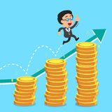 Businessman jumping over money stacks with green arrow background Stock Image