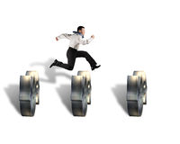 Businessman jumping over money symbol obstacles Stock Photos