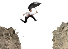 Businessman jumping over the mountains Royalty Free Stock Photo