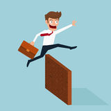 Businessman jumping over obstacle. Royalty Free Stock Photography