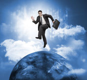 Businessman jumping over a planet Royalty Free Stock Photos
