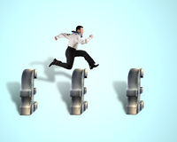 Businessman jumping over pound symbol Royalty Free Stock Images
