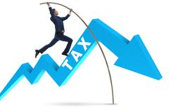 The businessman jumping over tax in tax evasion avoidance concept Stock Image