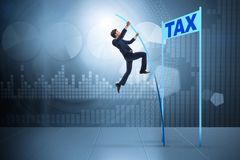 The businessman jumping over tax in tax evasion avoidance concept. Businessman jumping over tax in tax evasion avoidance concept Royalty Free Stock Photography
